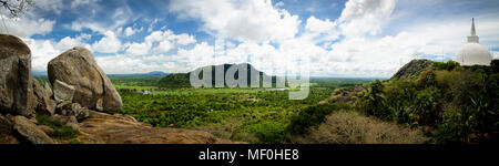 Sri Lanka, view from Mihintale monastery with Dagoba in foreground - Stock Photo