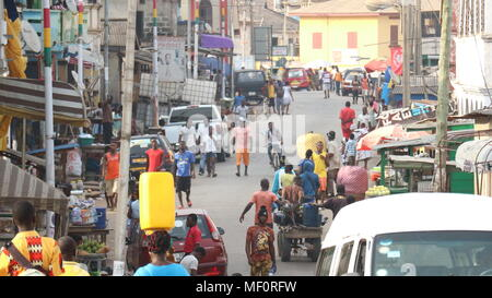 Busy street in Elmina, Ghana - Stock Photo