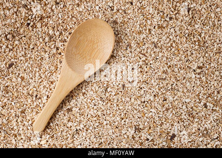 wooden spoon on wooden sawdust background - Stock Photo
