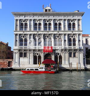 Casino di Venezia, Grand Canal, Venice, Italy,  blue sky, red boat, gambling - Stock Photo