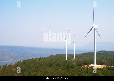Windmills on the mountains and clear sky - Stock Photo