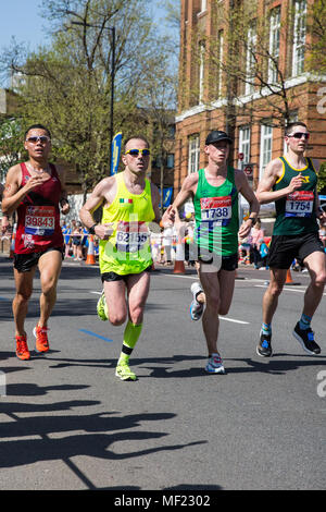 London, UK. 22nd April, 2018. Yipeng Lee, Antonio Belotti, Matthew Richards and Thomas Foster compete in the 2018 Virgin Money London Marathon. The 38th edition of the race was the hottest on record with a temperature of 24.1C recorded in St James's Park. - Stock Photo