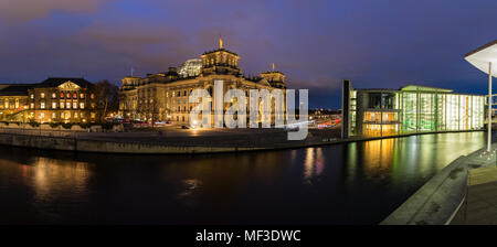 Germany, Berlin, Reichstag and Paul Loebe Government Building at Spree river in the evening - Stock Photo
