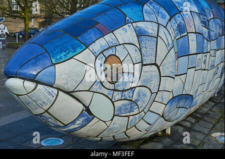 The Big Fish, The Salmon of Knowledge, on Donegall Quay on the banks of the River Lagan in Belfast was designed by John Kindness - Stock Photo
