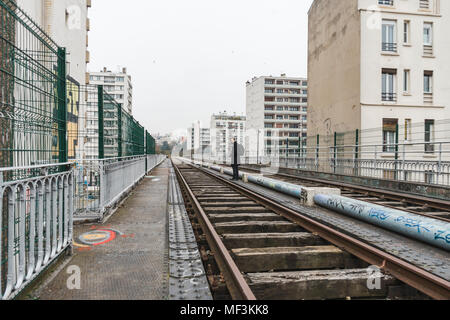 France, Paris, man walking along abandoned railway tracks - Stock Photo