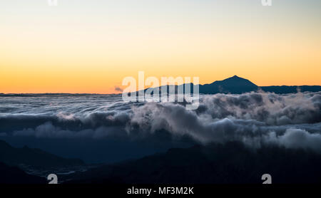 Spain, Canary Islands, Gran Canaria, view from Roque Nublo at sunset with Teide  on Tenerife in background - Stock Photo