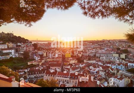 Portugal, Lisbon, View from Miradouro da Igreja da Graca, cityscape at sunset - Stock Photo