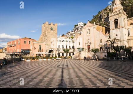 Piazza IX Aprile square, San Giuseppe church and Clock Tower in Taormina, Sicily. - Stock Photo