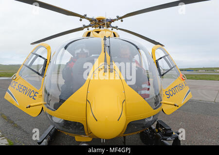 Scottish Ambulane Service helicopter on the apron at Sumburgh Airport Shetland - Stock Photo