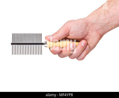 Hand with dogs grooming brush - Stock Photo