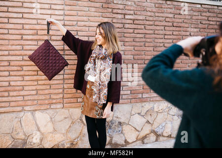 Fashion designers doing a photo shoot of their new products - Stock Photo