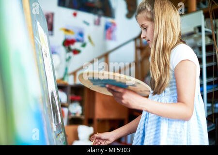 Girl Painting in Art Class - Stock Photo