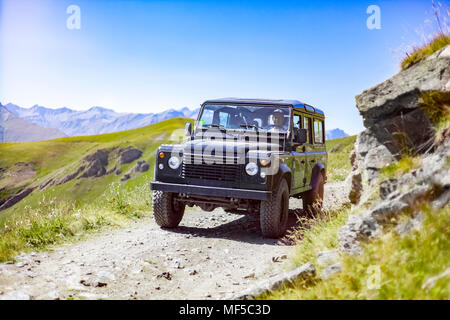 Italy, Piemont, West Alps, Landrover on Strada dei Cannoni - Stock Photo