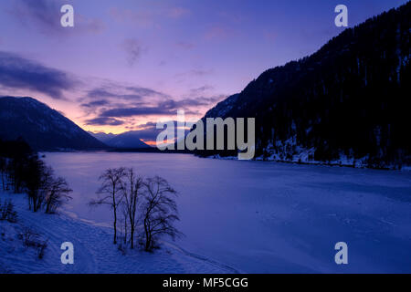Germany, Bavaria, Isarwinkel, Sylvenstein Dam in winter at sunset Stock Photo