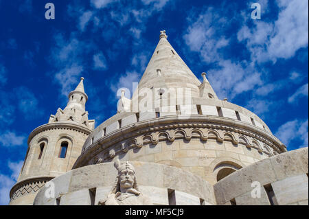 Towers of the Fisherman's Bastion,  terrace in neo-Gothic and neo-Romanesque style situated on the Buda bank of the Danube, on the Castle hill in Buda - Stock Photo