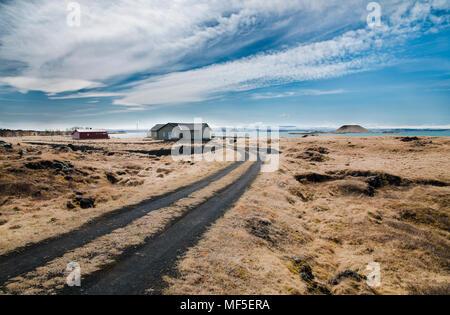Iceland, Myvatn, residential houses at lake - Stock Photo