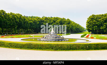 Statue of the fountain in front of the Herrenchiemsee Palace  , one of the most famous castles and the largest of King Ludwig II. - Stock Photo