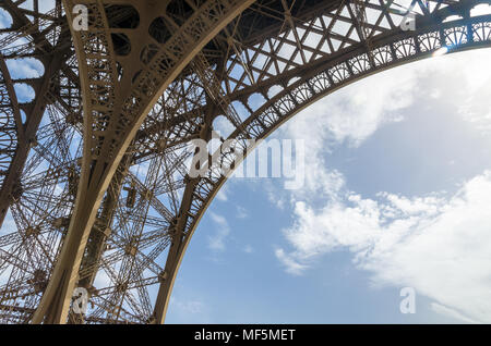 Low angle view of the wrought iron of the Eiffel Tower, Paris, France - Stock Photo