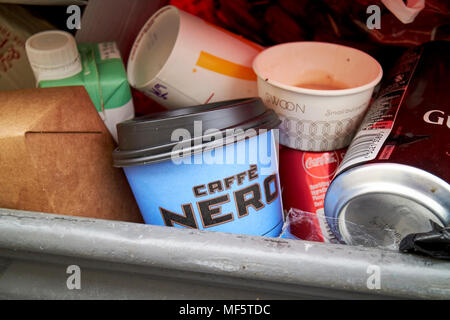 disposable coffee cups in commercial waste bin England UK - Stock Photo