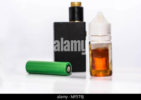 personal vaporizer with battery and q juice or e liquid, green battery and black e ciggaretes with liquid isolated in white background - Stock Photo