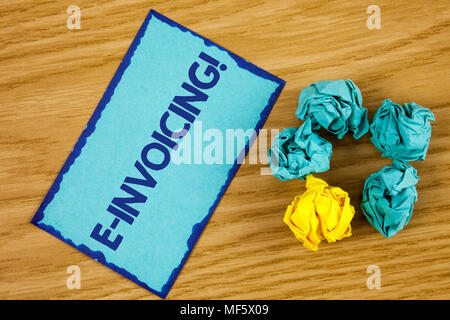 Word writing text E-Invoicing Motivational Call. Business concept for Company encourages use of digital billing written Sticky Note paper wooden backg - Stock Photo
