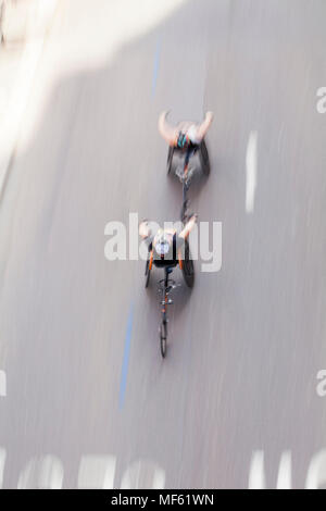 Two Para-Athletes compete at speed in their wheelchairs at the Marathon - April 22nd, 2018 London, UK - Stock Photo