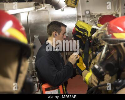 171031-N-DO281-045 ATLANTIC OCEAN (Oct. 31, 2017) Damage Controlman 2nd Class Shawn Vannatta trains Sailors during a main space fire drill, aboard the guided-missile cruiser USS Monterey (CG 61), October 31, 2017. Monterey is deployed in support of maritime security operations in the U.S. fifth and sixth fleet area of operations (U.S. Navy photo by Mass Communication Specialist Seaman Trey Fowler). () - Stock Photo