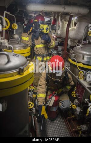 171031-N-DO281-117 ATLANTIC OCEAN (Oct. 31, 2017) Sailors respond to main engine room one during a main space fire drill aboard the guided-missile cruiser USS Monterey (CG 61), October 31, 2017. Monterey is deployed in support of maritime security operations in the U.S. 5th and 6th Fleet area of operations (U.S. Navy photo by Mass Communication Specialist Seaman Trey Fowler/Released). () - Stock Photo