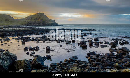 Sunset at the Giant Causeway, Northern Ireland, United Kingdom - Stock Photo