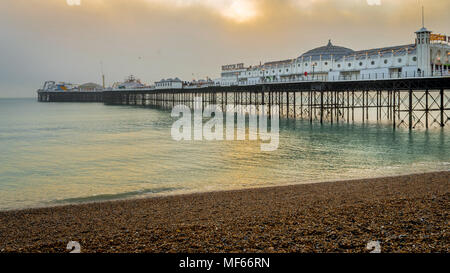 Brighton, Sussex, United Kingdom - 30 Dec, 2016 : A view of the Brighton Pier on a lovely winter evening just before sunset from the pebble beach - Stock Photo