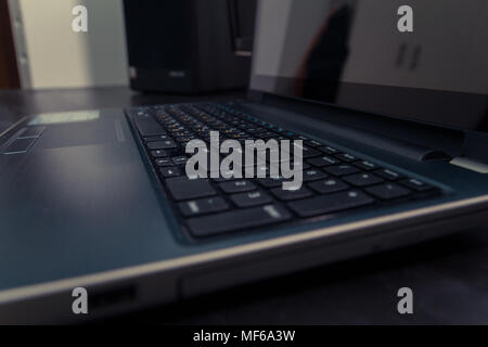 Keyboard with letters in Hebrew and English - Laptop keyboard - Stock Photo