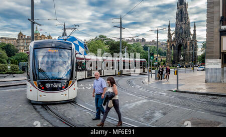 EDINBURGH, UNITED KINGDOM - AUGUST 1, 2016: A tram with Sir Walter Scott's monument in the background at Princes Street - Stock Photo
