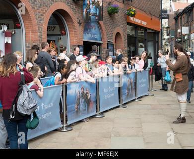 A re-enactor amuses a group of schoolchildren outside the Jorvik Viking Centre, York, Yorkshire, England, UK - Stock Photo