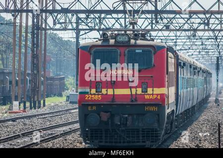 Kolkata, India - 4 March 2018: Express train pulled by an electric locomotive Engine traveling towards Howrah station after an overnight journey, Kolk - Stock Photo