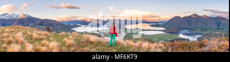 Hiker overlooking Lake Wanaka and mountains, Rocky Peak, Glendhu Bay, Otago, Southland, New Zealand - Stock Photo
