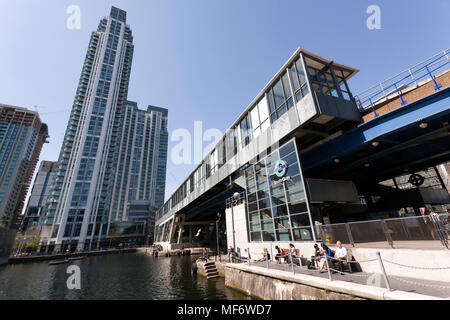 Wide-angle view of South Quay DLR Station, Millwall Inner Dock, Isle of Dogs, London. The  Pan Peninsula Towers are on the left side - Stock Photo