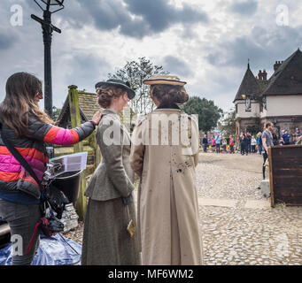 Great Budworth, UK. 9th April, 2018. women extras  dressed in Edwardian costumes having soot applied on the set of the new BBC drama 'War Of The Worlds - Stock Photo