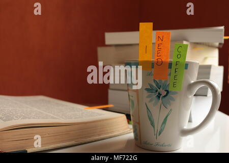 I need coffee mug with books - Stock Photo