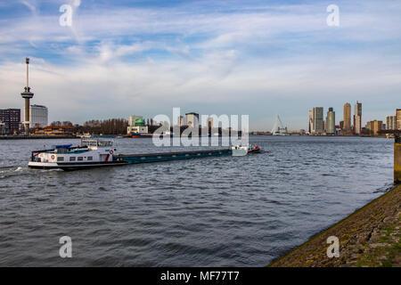 The skyline of Rotterdam, on the Nieuwe Maas, river, skyscrapers at the 'Kop van Zuid' district, Netherlands, Erasmus Bridge, - Stock Photo