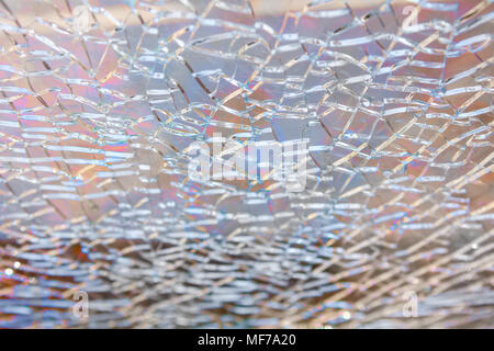 Abstract background: broken tempered glass texture. Selective focus, High angle view. - Stock Photo