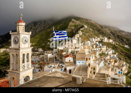 Greece, Aegean Islands, Olympos, Karpathos island, the church and the top of the village with the ruined windmill - Stock Photo