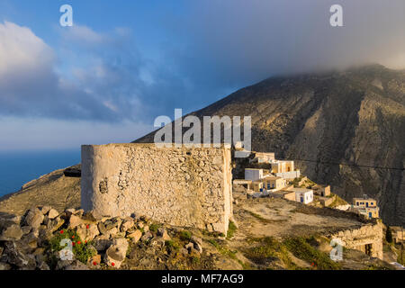 OLYMPOS,KARPATHOS ISLAND GREECE - july 30,2006 : the rest of a windmill on the heights - Stock Photo