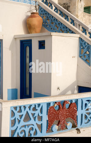 OLYMPOS,KARPATHOS ISLAND GREECE - july 30,2006 : openwork balustrades and the Byzantine eagle adorn many houses - Stock Photo