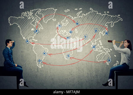 Global business concept as an young man and woman searching for a route on the worlds map. - Stock Photo