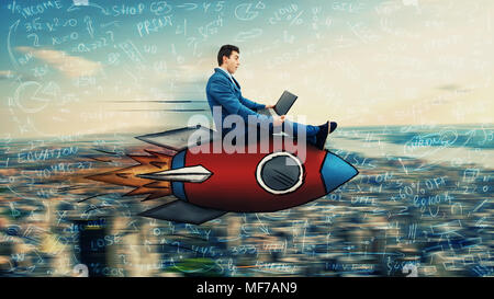 Wondered businessman flying over the city on a fast rocket looking at his laptop monitor. Global network speed concept. Business success and high targ - Stock Photo