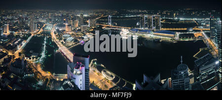 Singapore, Skyline at night with Marina Bay as seen from Alitude Bar - Stock Photo