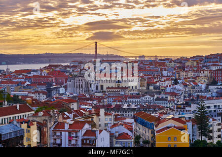 Portugal, Lisbon, cityscape with Ponte de 25 Abril at sunset - Stock Photo
