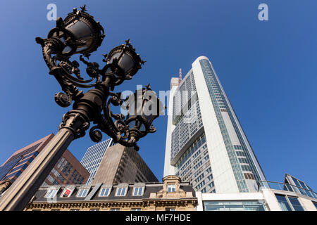 Germany, Hesse, Frankfurt, Candelabra and Commerzbank Tower - Stock Photo