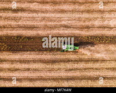 Combine harvester on a field of wheat, aerial view. - Stock Photo