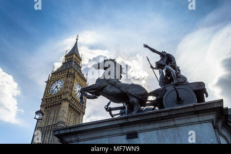Big Ben, London, United Kingdom - A view of the popular landmark with the statue of Boadicea, the clock tower known as Big Ben against a blue and clou - Stock Photo